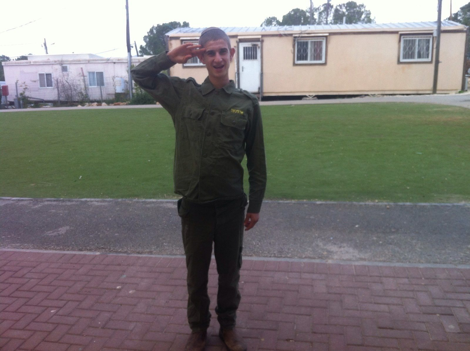 IDf soldier with special needs salutes in uniform