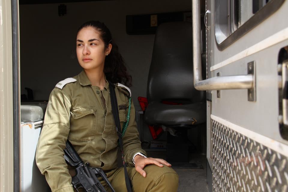 female IDF soldier with gun