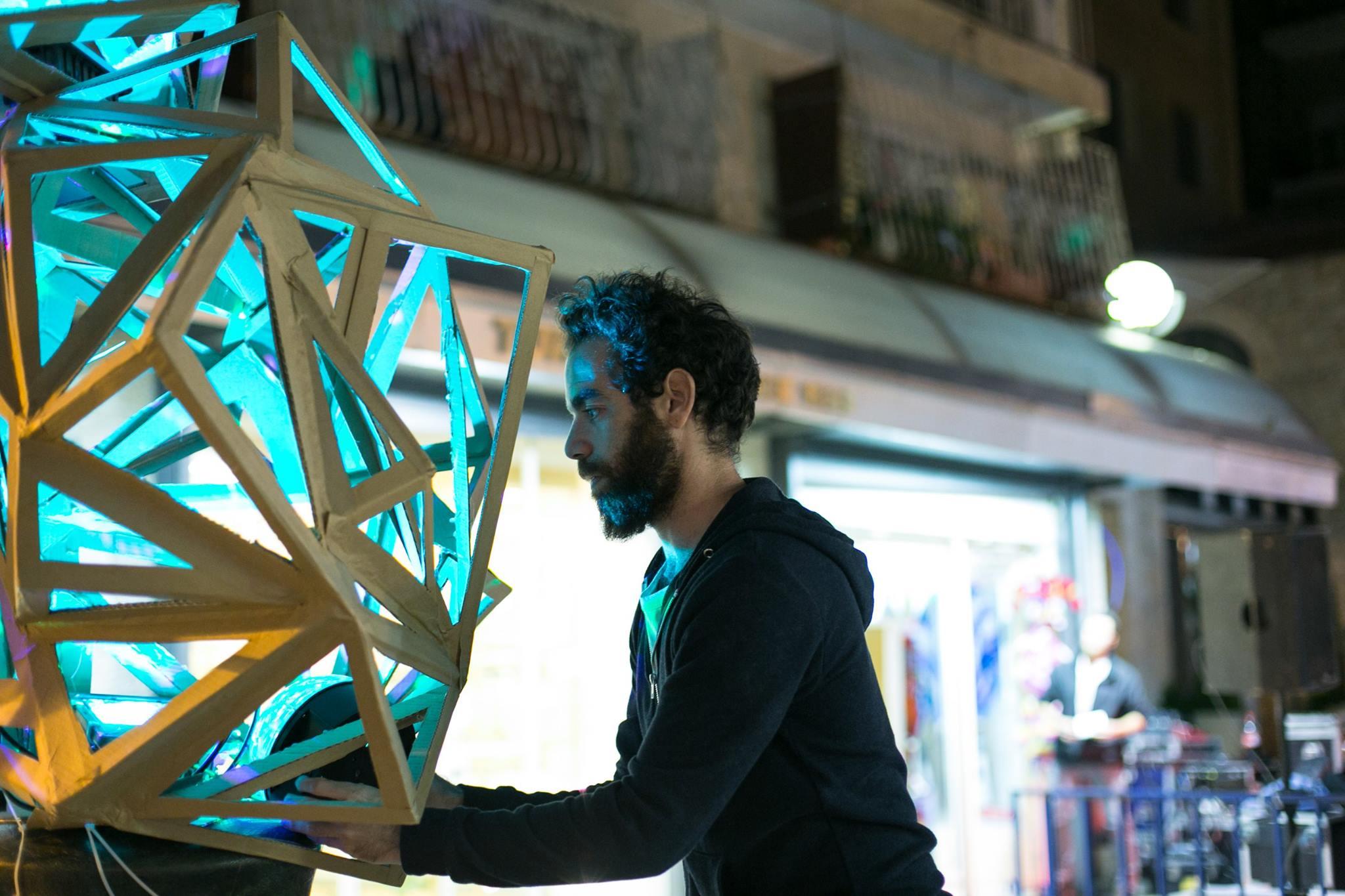 sculptor displays art piece in the street during Shaon Horef Jerusalem winter festival