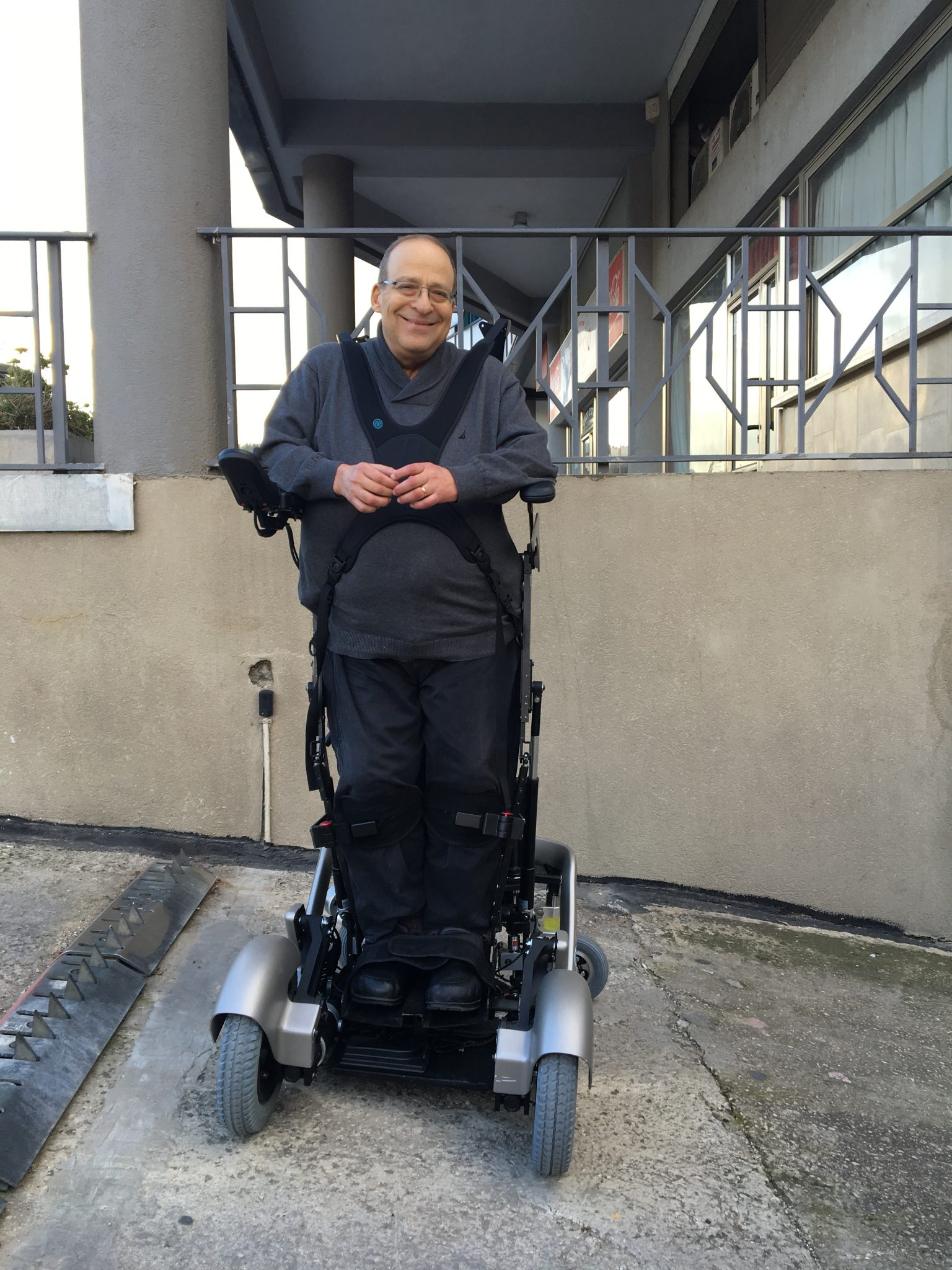 Founder of UpnRide trying out Israeli made upright wheelchair