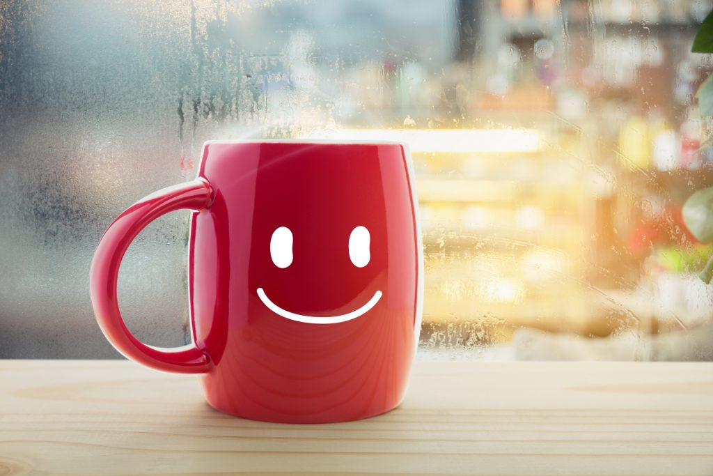 good is tov in hebrew so there is a mug with a smiley face conveying that all is good
