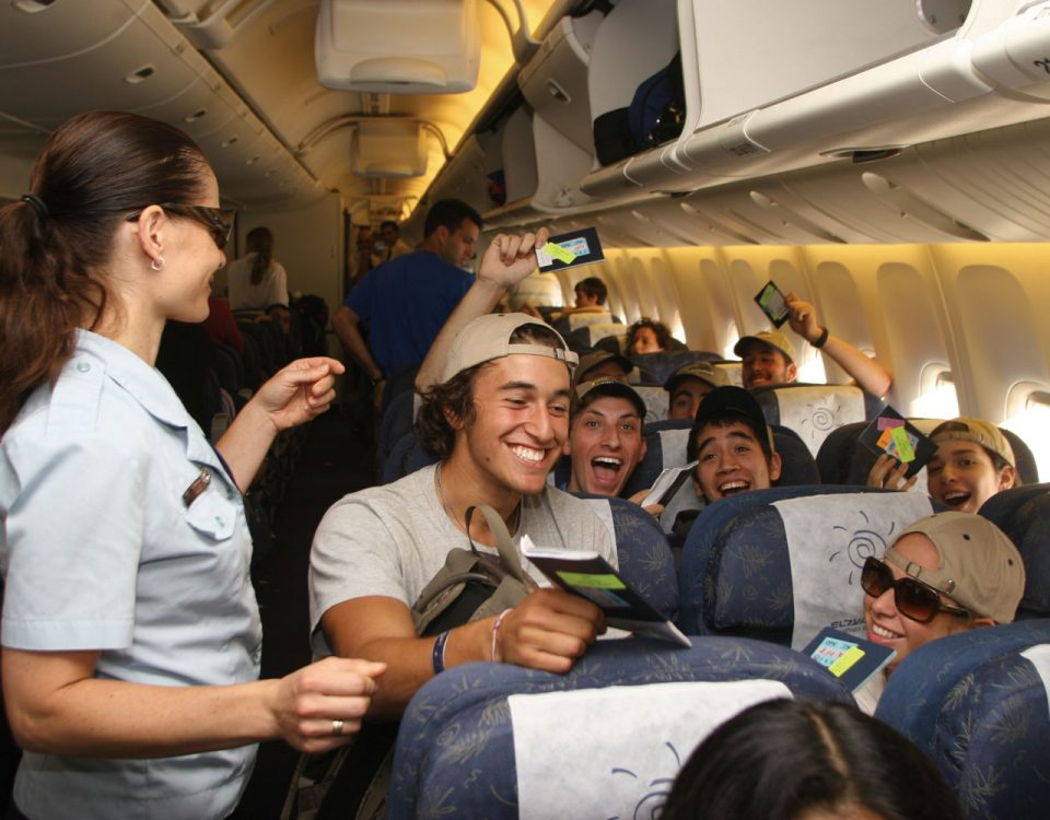 passengers flying to visit israel in an airplane