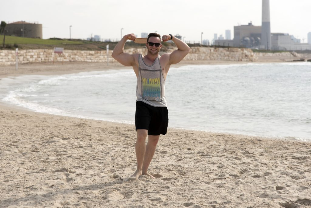 working out on the beaches of israel to get ris of the exis calories accumulated from the jewish holidays and summer vacation