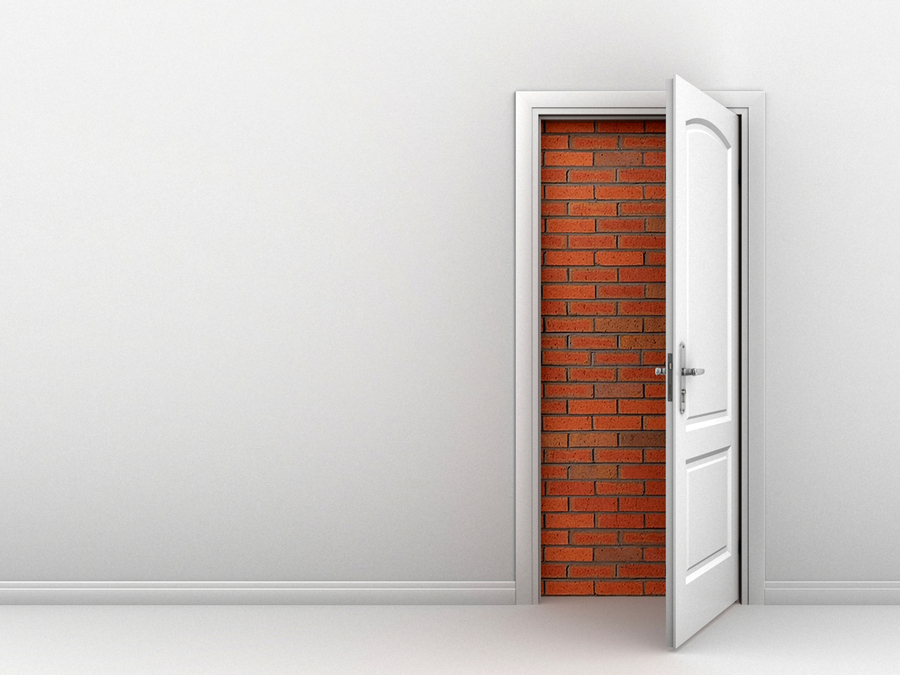 A door opened to a brick wall that simbolizes the inability of many people in the world who have no alternatives so the university of the people can help them get a new option to explore