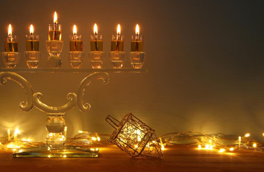understanding hanukkah. Hanukiah or menorah and dreidel celebrating light