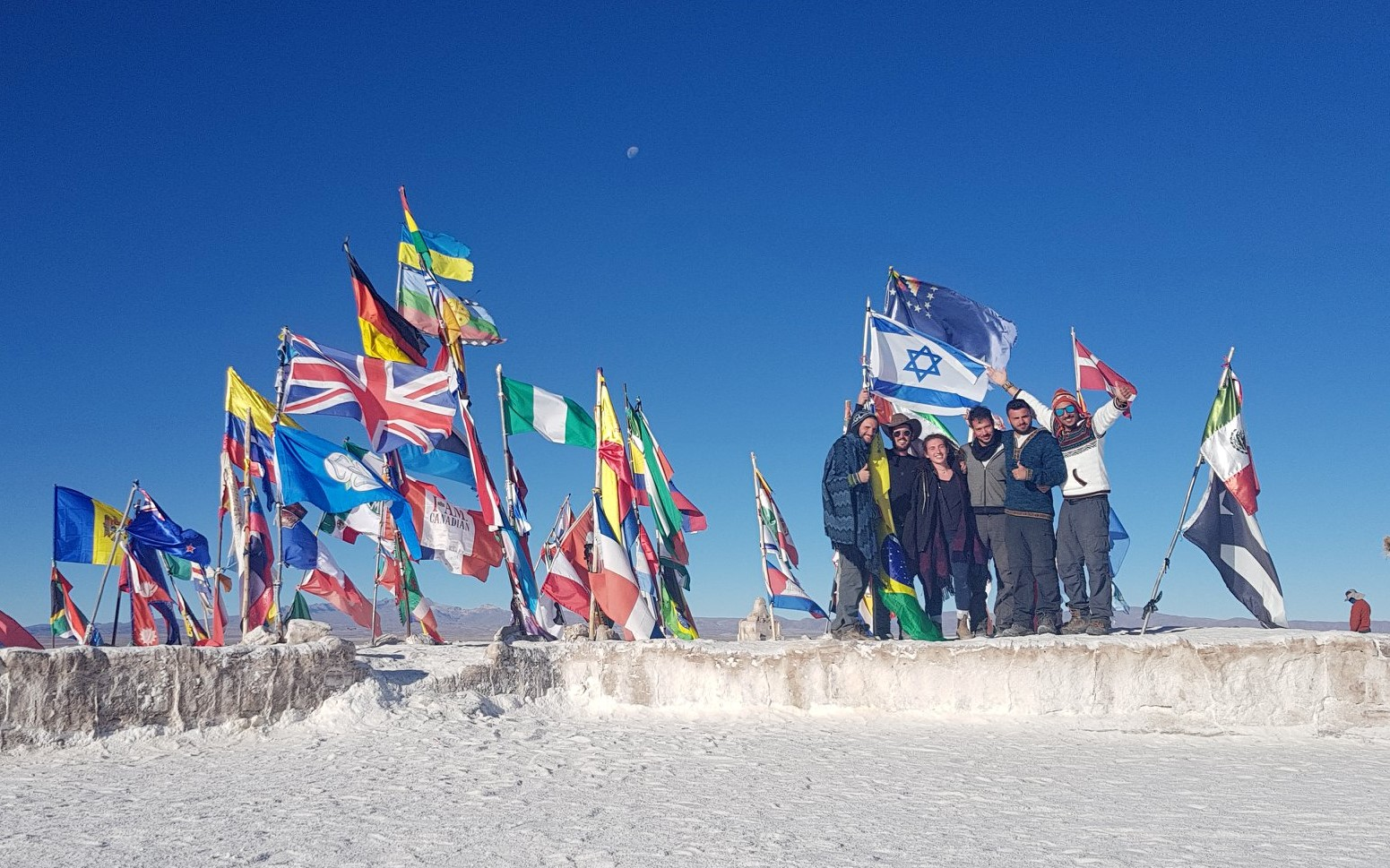 israeli group in the salt flats of bolivia holding israel flag